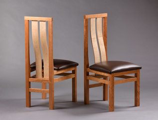 Pinnacle chair shown in Cherry with matched Curly Maple slats and leather seat.