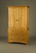 Pinnacle Armoire. Shown in Cherry with matched Curly Cherry door panels.