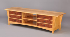 Fountain Brook media cabinet shown in Cherry with Pomele Sapele drawer fronts. and Wenge pulls.