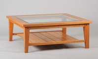 Chalford Farmhouse coffee table. Shown in natural Cherry with beveled glass top and shelf. 48