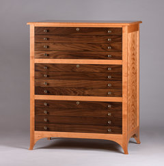 Cherry frame with Walnut drawer fronts and curly Cherry side panels.