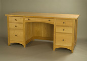 Desk shown in Cherry with 4 standard drawers, 2 file drawers and a pencil drawer.