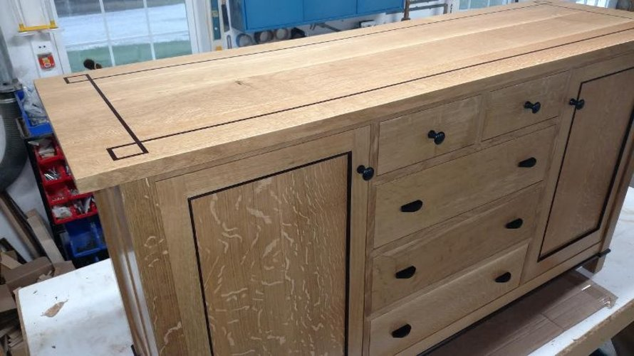 Oak sideboard with inlaid top.