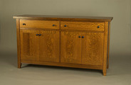 Chalford Farmhouse Sideboard. Shown here in quartered White Oak with mid stain.  Two drawers and four doors.  Adjustable shelves. Ebonzed pulls.