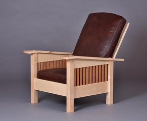 Maple chair with Cherry spindles and fully adjustable back. Mid brown leather covered goose down cushions.