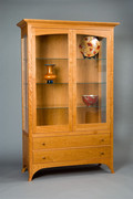 Large Regency Display Cabinet. Shown in Cherry with upper lighting and glass door panels.