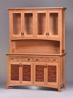 Cherry with glass and matched Bubinga door panels, curly Cherry drawer fronts and Wenge detailing.