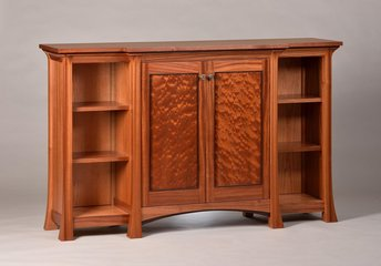 Shown here in ribbon Sapele with quilted Sapele door panels and Wenge detailing.