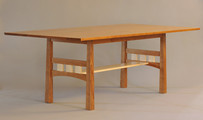 Pickwell Dining Table. Shown in Cherry with Curly Maple accents.