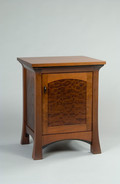 Pinnacle Nightstand. Shown in mid stained Mahogany with Quilted Makore door panel and Wenge accents.