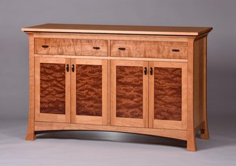 Cherry with matched Bubinga door panels, curly Cherry drawer fronts and Wenge detailing.