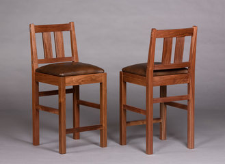 Barstool shown in Walnut with brown leather seat. Two wider slats replace the standard four spindles.
