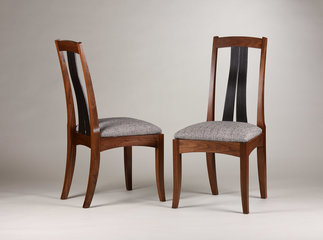 Walnut side chairs with ebonized slats.
