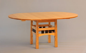 Pickwell Round Extending Breakfast Table. Shown here in Cherry with Wenge details.