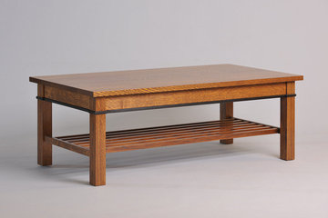 Gloucester Coffee Table. 52 x 26 x 18H. Shown in Quartered White Oak with mid stain and ebonized apron inlay. Solid top.