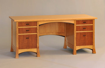 Pinnacle Desk. Shown in Cherry with Pomele Sapele drawer fronts and Wenge accents.