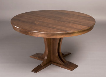 Regency Pedestal Extending Table. Shown here in Walnut. Round when closed.