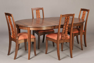 Fountain Brook side chairs shown with cabriole leg dining table in Walnut. Table extended.