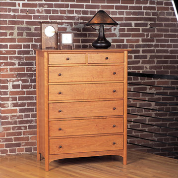 Sapperton Seven Drawer Chest. Shown in Cherry with Walnut pulls.