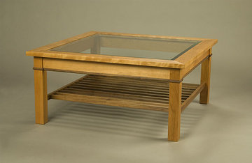 Gloucester Coffee Table. 38 x 38 x 18H. Shown in Cherry with Walnut apron inlay. Beveled glass top.