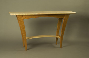 Fountain Brook server shown in Cherry with Curly Maple top and stretcher.