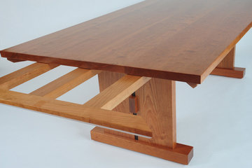 Slab Trestle table showing how the aprons extend to accept end leaves.