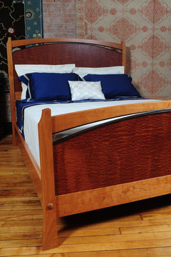 Queen size Pinnacle Bed. Shown in Cherry with matched Pomele Sapele panels and Wenge accents. Full footboard.
