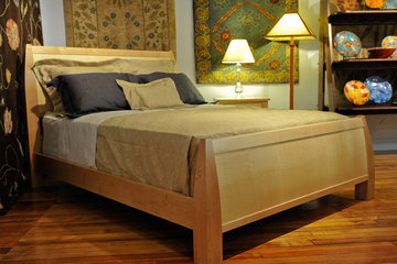 Queen size Gatsby bed. Shown with straight grain Maple frame and Curly Sycamore, vertical grain bowed panels.