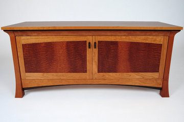 Pinnacle Media Cabinet. Shown in Cherry with Pomele Sapele door panels. Wenge accents.