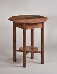 Walnut end table wit octagonal top and round shelf.