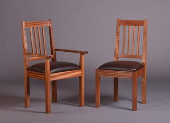 Chalford low-back dining chairs. Ribbon Sapele. Brown leather seats.