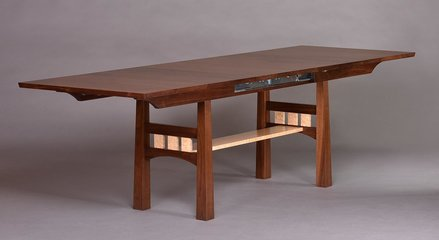 Walnut and curly Maple extending table shown extended with two 18