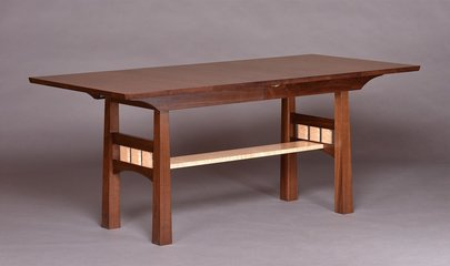 Pickwell leaf storage table shown in Walnut with Curly Maple accents and stretcher.