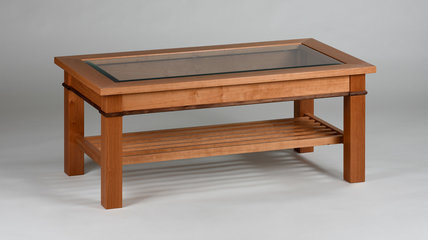 This is a little one at 48in long showing a Walnut apron detail, lower rack and beveled glass top.