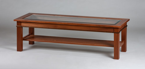 At 60in long this is a custom length showing Walnut in the apron detail, rack and beveled glass top.