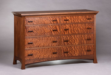 Pinnacle Eight Drawer Dresser. Shown in Walnut with quilted Sapele drawer fronts and Wenge accents.