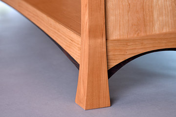 Detail showing sweep of the lower leg and the effect of tighter radius of the dark Wenge detail against the larger radius of the rail above.