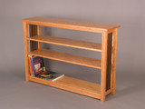 Gloucester Bookcase. Shown in Cherry with Walnut side spindles and adjustable shelves.