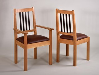 Oak dining chairs with Wenge spindles and leather seats. 38