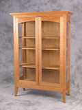 Regency Display Cabinet. Shown in Cherry with Glass doors and side panels.